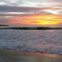 Photo taken at Jimbaran Beach Cafe by Robert T. on 3/27/2017