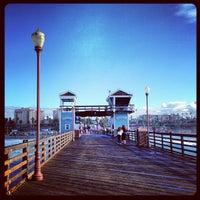 Photo taken at Oceanside Pier by Rita S. on 12/30/2012