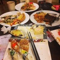 Photo taken at Shogun Japanese Buffet Restaurant by ikhwan n. on 7/15/2013