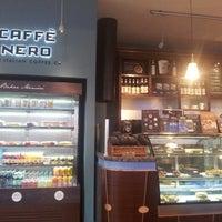 Photo taken at Caffé Nero by Melih U. on 3/9/2013