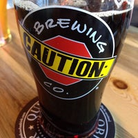 Photo taken at CAUTION: Brewing Company by Zach K. on 1/26/2014