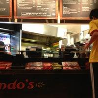 Photo taken at Nando's by Alex on 2/17/2013