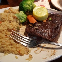 Photo taken at Outback Steakhouse by Alyssa H. on 5/5/2015