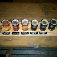 Photo taken at Highland Brewing Company by BJ L. on 2/24/2013