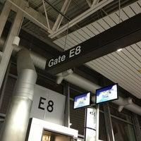 Photo taken at Gate E8 by Teresa J. on 12/29/2012
