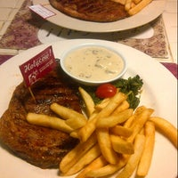 Photo taken at Holycow! Steakhouse by Ucie R. on 5/9/2013