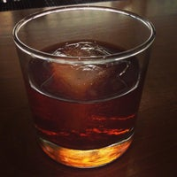 Photo taken at The Corner Office Restaurant & Martini Bar by Colfax D. on 5/1/2015