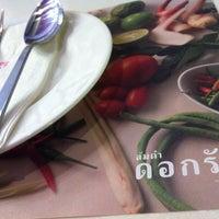 Photo taken at Somtum Dok Ruk @ Chongkosamosorn Silom by Nawaporn M. on 7/10/2013