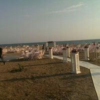 Photo taken at Gümüldür Özdere Beach by Ayten Ü. on 9/20/2015