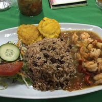 Photo taken at Guilligans Caribbean Food by Yusett R. on 7/27/2016