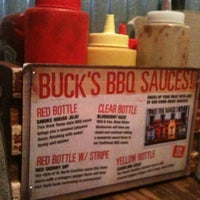 Photo taken at Buck's Naked BBQ by Andrea C. on 4/14/2013
