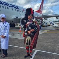 Photo taken at Edinburgh Airport (EDI) by Batuhan A. on 7/16/2015