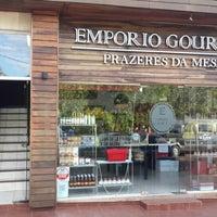 Photo taken at Empório Gourmet by Pedro Ivo B. on 3/27/2014
