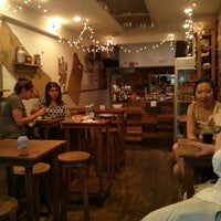 Photo taken at Piccolo Cafe by Joshua B. on 6/24/2013