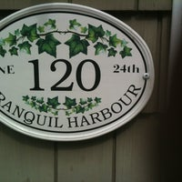 Photo taken at Tranquil Harbour by Adrienne H. on 7/21/2013