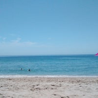 Photo taken at Praia dos Amigos by david g. on 8/18/2014
