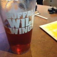 Photo taken at Buffalo Wild Wings by Beth B. on 1/4/2014