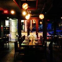 Photo taken at Moonshine Modern Supper Club by Nikolai C. on 10/8/2012
