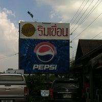 Photo taken at ริมเขื่อน (Rim Khuean Restaurant) by Daow Ja D. on 10/27/2012