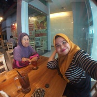 Photo taken at The Hangout Cafe by Yusna Y. on 5/12/2016