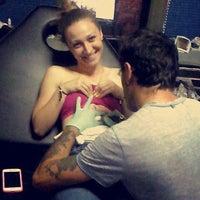 Photo taken at Bobi Tattoo InkS by Angela T. on 7/1/2015