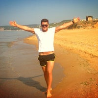 Photo taken at Solar Beach by EyupCapoglu C. on 5/5/2013