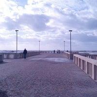 Photo taken at Pontile di Ostia by Antonio V. on 11/30/2012