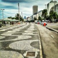 Photo taken at Calçadão do Leme by Gustavo C. on 5/6/2013