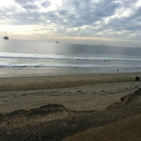 Photo taken at Huntington Dog Beach by Caitlin G. on 1/1/2013