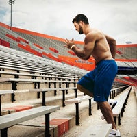 Photo taken at Ben Hill Griffin Stadium by Men's Health Mag on 8/3/2014