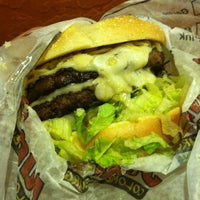 Photo taken at Junior Colombian Burger by katie b. on 10/11/2012
