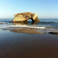 Photo taken at Natural Bridges State Beach by Jorge E. on 5/20/2013