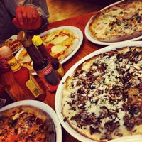Photo taken at California Pizza Kitchen by Carolina S. on 7/3/2013