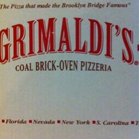 Photo taken at Grimaldi's Pizzeria by T.J. M. on 11/10/2012