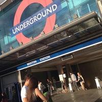 Photo taken at Brixton London Underground Station by Rhammel A. on 7/28/2013