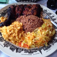 Photo taken at Caribbean Feast Cuisine by Lauryn A. on 8/22/2014