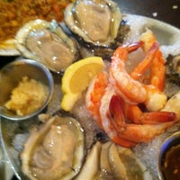 Photo taken at Pappadeaux Seafood Kitchen by Cristina on 6/30/2013