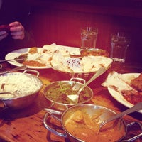 Photo taken at Brick Lane Curry House by Jesse M. on 12/19/2012