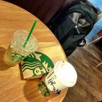 Photo taken at Starbucks by Rey G. on 1/12/2013
