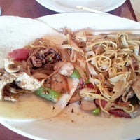 Photo taken at Mongolian Grill by Nikolaos P. on 8/19/2013
