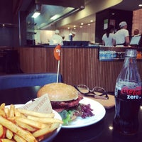Photo taken at Charlie & Co. Burgers by David G. on 6/22/2014