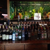 Photo taken at Knight Cap Bar & Lounge by Michael D. on 9/21/2013
