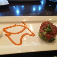 Photo taken at Okura Robata Sushi Bar and Grill by Debbie M. on 2/18/2013