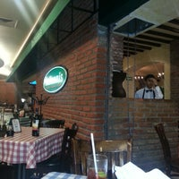 Photo taken at Italianni's Pizza, Pasta & Vino by Angélica S. on 4/2/2013
