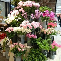 Photo taken at Aoyama Flower Market by Toshi Y. on 1/9/2016