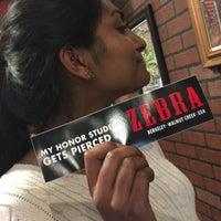 Photo taken at Zebra Tattoo & Body Piercing by Doobya on 7/13/2017