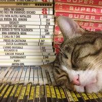 Photo taken at Libreria Acqua Alta by Misha K. on 8/4/2013