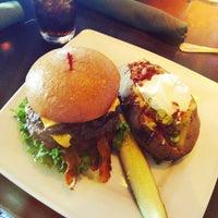 Photo taken at Bombshells Restaurant & Bar by Aaron A. on 6/9/2013