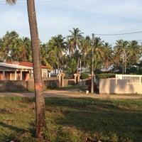 Photo taken at Praia Boca da Barra by Jahdson P. on 12/24/2013