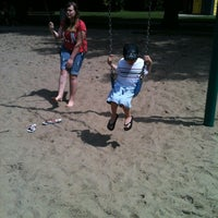Photo taken at Elmwood Park Playground by Jennifer R. on 7/23/2013